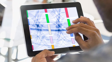 Hand swiping across a data visualization on a tablet